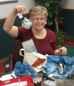 Judy Hoffman Showing off her New Ornament